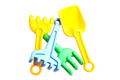 Toy rakes and shovels for sandbox. Plastic children toy rakes and shovels for sandbox isolated on white background Royalty Free Stock Photography