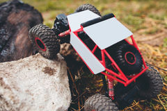 Toy rc suv on stone, top view, free space Royalty Free Stock Image
