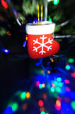 Toy red boots Santa Claus on Christmas tree Royalty Free Stock Photos