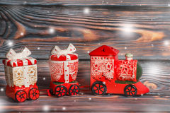 Toy red christmas train on a dark wooden background Royalty Free Stock Photo