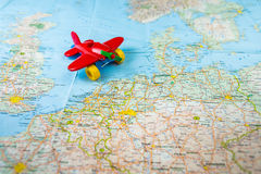 The toy red cute airplane is on the map of Europe. Royalty Free Stock Photos