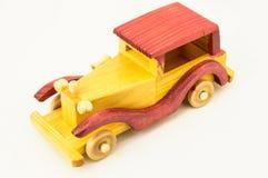 Toy Red de madera y coche amarillo Foto de archivo libre de regalías