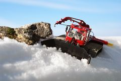 Toy red ratrak in the snow. Royalty Free Stock Image