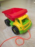 Toy red yellow green plastic car truck Royalty Free Stock Image
