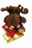 Toy reindeer with presents Stock Images