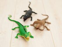 Toy reptilians attack Stock Photo