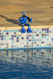 Toy resting. When toy goes to swimming pool Stock Photo