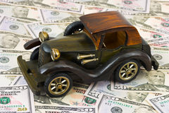 Toy retro car on money background Stock Photo