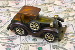 Toy retro car on money background Stock Images