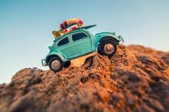 Toy retro car on rock Stock Image
