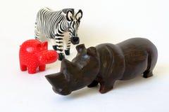 Toy rhino, zebra and hyppo. Wodden model of Toy rhino, zebra and hyppo stock images