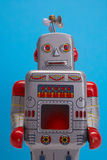 Toy robot. Vintage toy robot on blue background Stock Photos