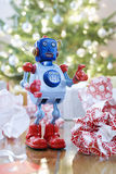 Toy Robot In Front Of Christmas Tree Royalty Free Stock Photos