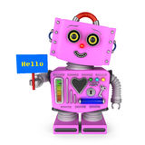 Toy robot girl holding hello sign. Pink vintage toy robot girl with head tilted to the side smiling and holding a hello sign over white background Royalty Free Stock Photo