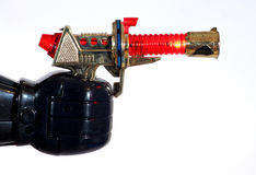 Toy robot hand holding a lighting gun Stock Photo