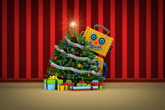 Toy robot happy with christmas tree and presents Stock Images