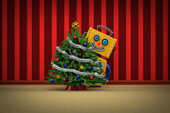 Toy robot happy with christmas tree Stock Photos