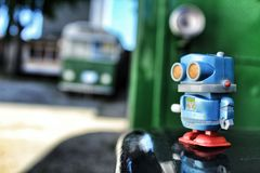 Toy robot on old bus school royalty free stock photography