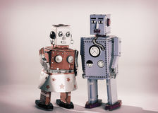 Toy Robots. Vintage toy robots male and female Stock Images