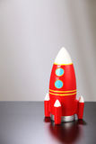 Toy rocket. On the black table top Stock Photo