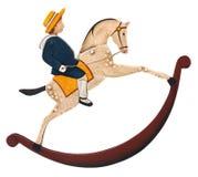 Toy Rocking häst med pojken fotografering för bildbyråer