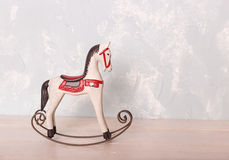 Free Toy Rocking Horse On The Wooden Floor Against The Backdrop Of A Royalty Free Stock Images - 67804309