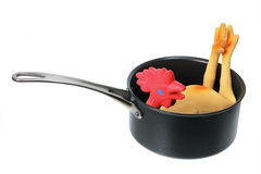 Toy Rubber Chicken in Saucepan Royalty Free Stock Image