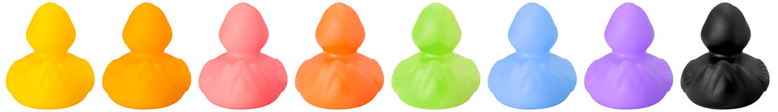 Toy rubber colored ducks back side Stock Photos