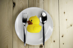 Toy rubber duck on a plate Stock Photo