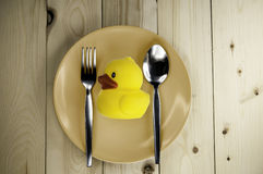 Toy rubber duck on a plate Stock Photography