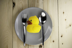 Toy rubber duck on a plate Royalty Free Stock Image
