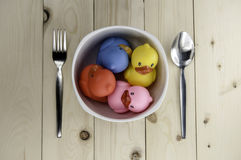 Toy rubber duck on a plate Stock Photos
