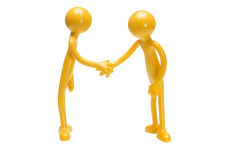 Toy rubber figurines shaking hands Royalty Free Stock Image