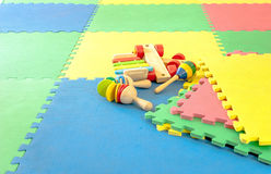 Toy on rubber foam. Puzzles Royalty Free Stock Images