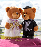 Toy Russian bears with wedding rings Royalty Free Stock Images