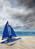 Toy sailboat in the sand Stock Photos