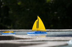 Toy sailboat in water Stock Image