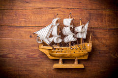 Toy sailboat on a wooden background Royalty Free Stock Photo