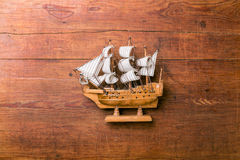Toy sailboat on a wooden background Royalty Free Stock Photography