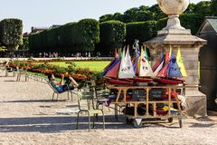 Toy sailboats for rent near the pond in the Luxembourg Gardens. Paris, France - July 07, 2017: Toy sailboats for rent near the pond in the Luxembourg Gardens Stock Images