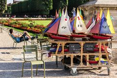Toy sailboats for rent near the pond in the Luxembourg Gardens. Paris, France - July 07, 2017: Toy sailboats for rent near the pond in the Luxembourg Gardens Stock Photos