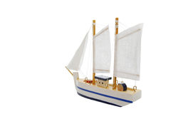 Toy sailing boat. On white background royalty free stock photography