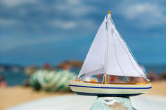 Toy saill boat at the beach Stock Photo