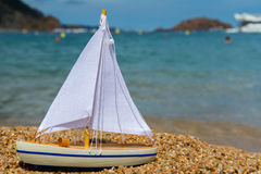 Toy saill boat at the beach Stock Photography