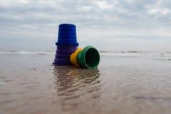 Toy sand bucket bright blue on beach. Close up stock photos