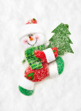 Toy Santa with Christmas tree walks Stock Image