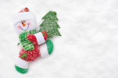 Toy Santa with Christmas tree walks Royalty Free Stock Image