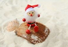 Toy Santa Claus on a beach Stock Images