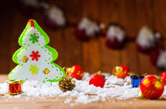 Toy Santa Claus and Christmas tree on the old wooden table. Stock Images