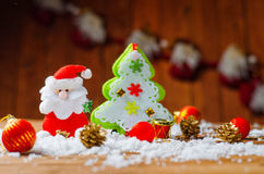 Toy Santa Claus and Christmas tree on the old wooden table. Royalty Free Stock Photography